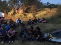 Del Rio Sector Border Patrol agents apprehend a human smuggler and 22 migrants who crossed the river in a small raft. (Photo: U.S. Border Patrol/Del Rio Sector)