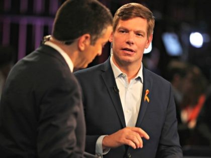 Democratic presidential candidate Rep. Eric Swalwell (D-CA) speaks during a television interview in the spin room before the second night of the first Democratic presidential debate June 27, 2019 in Miami, Florida. A field of 20 Democratic presidential candidates was split into two groups of 10 for the first debate …