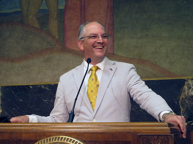 Democratic Gov. John Bel Edwards smiles as he describes the end of a legislative session that saw his teacher pay raise and education spending plans win final passage, on Thursday, June 6, 2019, in Baton Rouge, La. (AP Photo/Melinda Deslatte)