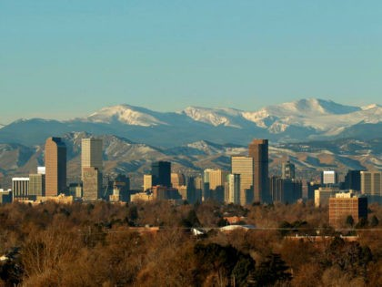 The Rocky Mountains rise beyond Denver skyline Sunday, Jan. 24, 2016. (AP Photo/Charlie Riedel)