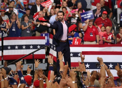 ORLANDO, FLORIDA - JUNE 18: Donald Trump Jr. tosses campaign hats to the crowd before his father, United States President Donald Trump, arrives on stage to announce his candidacy for a second presidential term at the Amway Center on June 18th in Orlando, Florida, President Trump is set to run …
