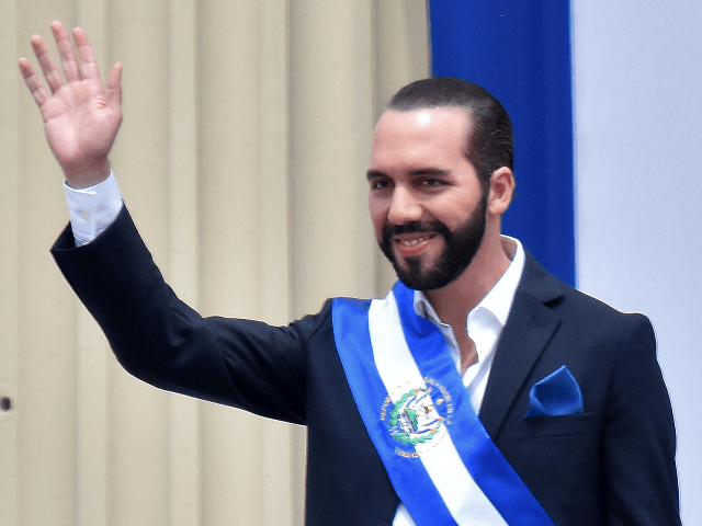 Salvador's new president, Nayib Bukele, waves during his inauguration ceremony at Gerardo Barrios Square outside the National Palace in downtown San Salvador, on June 1, 2019. - Bukele, 37, who was elected in February to succeed Salvador Sanchez Ceren, has said he will seek closer ties with the United States, …