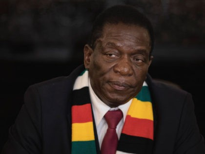 HARARE, ZIMBABWE - AUGUST 03: President-elect, Emmerson Mnangagwa conducts a press conference on August 3, 2018 in Harare, Zimbabwe. Zimbabwe Electoral Commission (ZEC) officials last night announced the re-election of President Emmerson Mnangagwa of the ruling Zimbabwe African National Union - Patriotic Front (ZANU-PF). The election was the first since …
