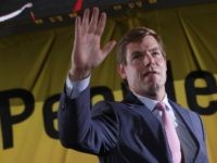 "WASHINGTON, DC - JUNE 17: Democratic U.S. presidential candidate Rep. Eric Swalwell (D-CA) waves as he leaves the Moral Action Congress of the Poor People's Campaign June 17, 2019 at Trinity Washington University in Washington, DC. The Campaign held the event to focus on issues like ""voting rights, health care, …"