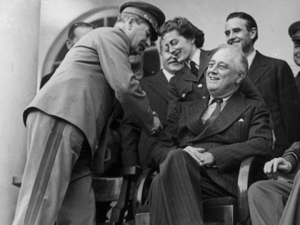7th December 1943: American statesman Franklin Delano Roosevelt, the 32nd President of the United States of America, British Prime Minister Winston Churchill and Soviet leader Joseph Stalin during a conference at Teheran. Stalin greets Sarah Churchill. (Photo by Evening Standard/Getty Images)