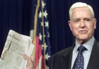 WASHINGTON, : Senator Ernest Hollings, D-SC, holds up a copy of the New York Times after the Senate voted to pass the airline security bill 16 November 2001 on Capitol Hill. A House vote later in the day sends the bill, a product of weeks of negotiations, to US President …