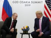 Russian President Vladimir Putin and US President Donald Trump hold a meeting on the sidelines of the G20 summit in Osaka on June 28, 2019. (Photo by Mikhail Klimentyev / SPUTNIK / AFP) (Photo credit should read MIKHAIL KLIMENTYEV/AFP/Getty Images)
