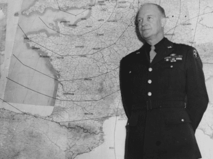 General Dwight Eisenhower standing in front of a large wall map in his office, London, January 17th 1944. (Photo by Keystone/Hulton Archive/Getty Images)