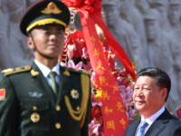 Chinese President Xi Jinping walks past a soldier after laying a wreath at the Monument to the People's Heroes during a ceremony in Beijing's Tiananmen Square, on the eve of National Day on September 30, 2018. - China marks its National Day, the 69th anniversary of the founding of the …