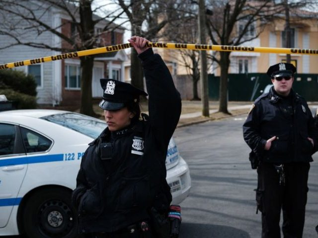 """NEW YORK, NEW YORK - MARCH 14: Police stand along the street where reputed mob boss Francesco """"Franky Boy"""" Cali lived and was gunned down on March 14, 2019 in the Todt Hill neighborhood of the Staten Island borough of New York City. Cali, 53, was a top leader of …"""