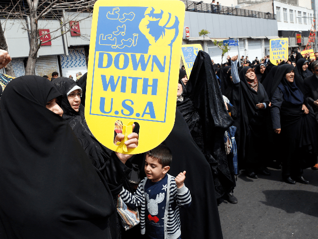 "Iranians chant slogans during an anti-US rally following Friday prayers in Tehran on April 12, 2019. - Iranian President Hassan Rouhani this week accused the United States of being the real ""leader of world terrorism"", hitting back after Washington blacklisted Iran's Revolutionary Guards as a terrorist organisation. Tehran was quick …"