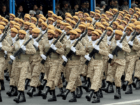 "Iranian soldiers march during a military parade as they mark the country's annual army day in Tehran, on April 18, 2019. - Iran's President Hassan Rouhani called on Middle East states on April 18 to ""drive back Zionism"", in an Army Day tirade against the Islamic republic's archfoe Israel. Speaking …"