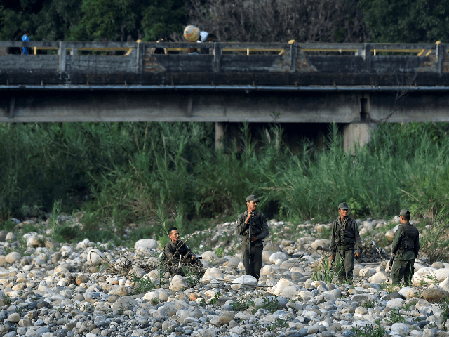 "Venezuelan soldiers guard ""trochas"" -illegal trails- used by people to cross from San Antonio del Tachira, in Venezuela, to Cucuta, in Colombia, near the Simon Bolivar international bridge, on May 1, 2019. (Photo by Luis ROBAYO / AFP) (Photo credit should read LUIS ROBAYO/AFP/Getty Images)"