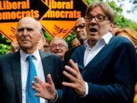 Britain's leader of the Liberal Democrat party, Vince Cable (L) and the European Parliament's chief Brexit negotiator and Leader of the Alliance of Liberals and Democrats for Europe party, Guy Verhofstadt (R) speak to members of the media before canvassing for support for their candidates in the forthcoming European elections, …