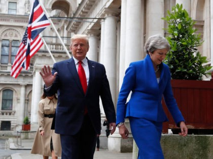 LONDON, ENGLAND - JUNE 04: Britain's Prime Minister Theresa May and President Donald Trump walk through the Quadrangle of the Foreign Office for a joint press conference in central London on the second day of the U.S. President and First Lady's three-day State visit on June 4, 2019 in London, …