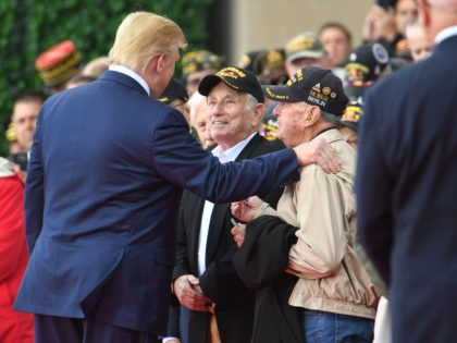 TOPSHOT - US President Donald Trump (L) meets with WWII veterans during a French-US ceremony at the Normandy American Cemetery and Memorial in Colleville-sur-Mer, Normandy, northwestern France, on June 6, 2019, as part of D-Day commemorations marking the 75th anniversary of the World War II Allied landings in Normandy. (Photo …