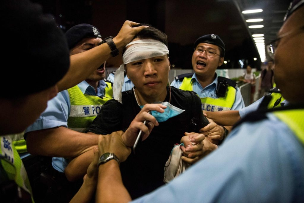 A protester is arrested after a rally against a controversial extradition law proposal in Hong Kong on June 10, 2019. - Hong Kong witnessed its largest street protest in at least 15 years on June 9 as crowds massed against plans to allow extraditions to China, a proposal that has sparked a major backlash against the city's pro-Beijing leadership. (Photo by ISAAC LAWRENCE / AFP) (Photo credit should read ISAAC LAWRENCE/AFP/Getty Images)