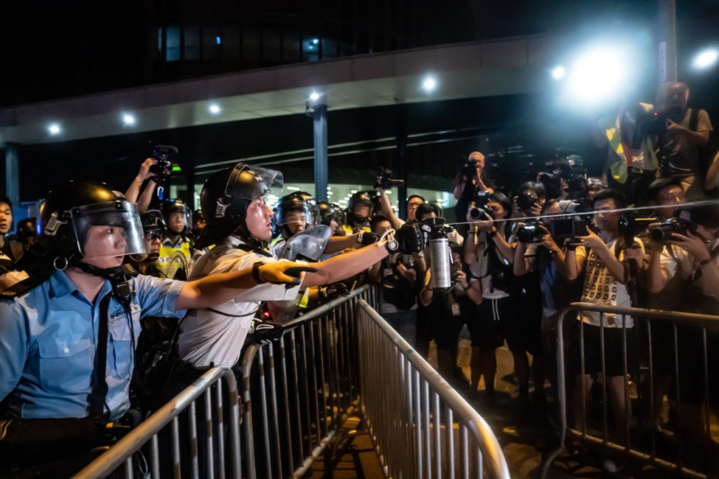 HONG KONG - JUNE 10: Protesters clash with police after a rally against the extradition law proposal at the Central Government Complex on June 10, 2019 in Hong Kong. Organizers say more than a million protesters marched on Sunday against a bill that would allow suspected criminals to be sent to mainland China for trial as tensions have escalated in recent weeks. (Photo by Anthony Kwan/Getty Images)