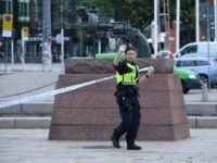 A policewoman stands guard outside the central train station after a man threatened to detonate a bomb in Malmö in southern Sweden on June 10, 2019. - The station building was evacuated due to alarms about a suspected object. The man was wounded by police and his bag destroyed by …