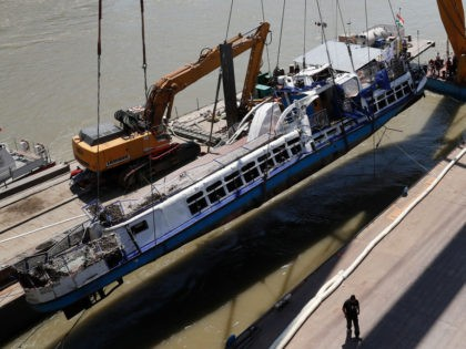 BUDAPEST, HUNGARY - JUNE 11: The tourist boat the Mermaid is raised from the Danube river on June 11, 2019 in Budapest, Hungary. At least 20 people died in the May 29 accident when a larger sightseeing vessel collided with the Mermaid, a small boat carrying mostly South Korean tourists, …