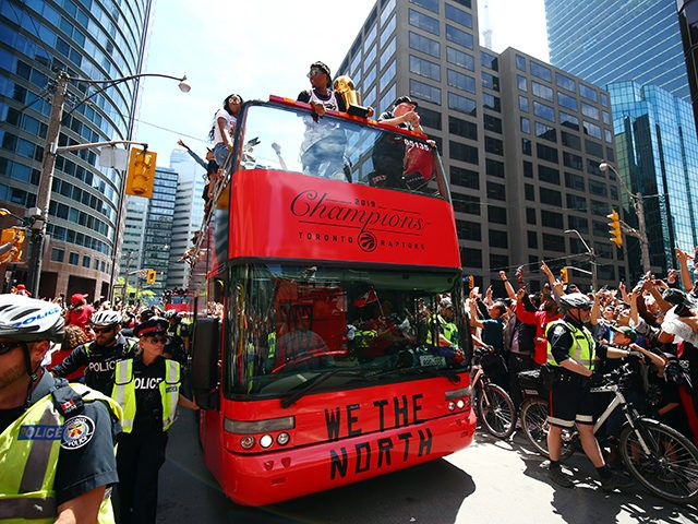 TORONTO, ON - JUNE 17: Kyle Lowry #7 of the Toronto Raptors holds the championship trophy during the Toronto Raptors Victory Parade on June 17, 2019 in Toronto, Canada. The Toronto Raptors beat the Golden State Warriors 4-2 to win the 2019 NBA Finals. NOTE TO USER: User expressly acknowledges …