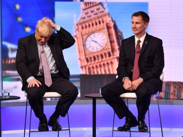 LONDON, ENGLAND - JUNE 18: In this handout photo provided by the BBC, (L-R) MP Boris Johnson and Secretary of State for Foreign Affairs Jeremy Hunt participate in a Conservative Leadership televised debate on June 18, 2019 in London, England. Emily Maitlis hosts the second of the televised Conservative Leadership …
