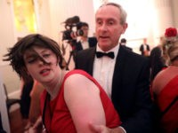 "LONDON, ENGLAND - JUNE 20: A climate change protester is escorted out after interrupting a speech during the annual Mansion House dinner on June 20, 2019, in London, England. Greenpeace volunteers wearing red evening dress with sashes reading ""climate emergency"" gatecrashed and disrupted the beginning of Chancellor Philip Hammond's Mansion …"