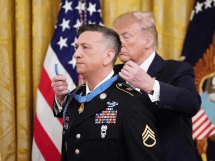 US President Donald Trump presents the Medal of Honor to David Bellavia in the East Room of the White House in Washington, DC on June 25, 2019. - Bellavia is receiving the award for actions he took on November 10, 2004 while serving with the US Army in Fallujah, Iraq. …