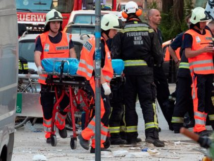 Austrian rescuers and firefighters work at the site of an explosion in which an apartment building collapsed in the city center of Vienna, Austria on June 26, 2019. - At least two people were seriously injured, ten lightly, and searches continue for possible missing people, following what medias report to …