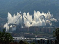 GENOA, ITALY - JUNE 28: The pylons 10 and 11 of the collapsed Morandi viaduct are demolished with a controlled dynamite explosion on June 28, 2019 in Genoa, Italy. The Morandi viaduct collapsed on August 14, 2018 causing the death of 43 people. (Photo by Pier Marco Tacca/Getty Images)
