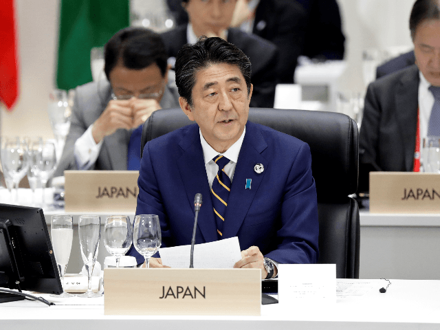 OSAKA, JAPAN - JUNE 28: Shinzo Abe, Japan's prime minister, center, speaks during a working lunch on the first day of the G20 summit on June 28, 2019 in Osaka, Japan. U.S. President Donald Trump arrived in Osaka on Thursday for the annual Group of 20 gathering together with other …
