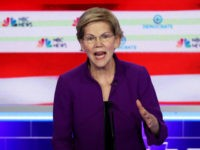 MIAMI, FLORIDA - JUNE 26: Sen. Elizabeth Warren (D-MA) speaks during the first night of the Democratic presidential debate on June 26, 2019 in Miami, Florida. A field of 20 Democratic presidential candidates was split into two groups of 10 for the first debate of the 2020 election, taking place …