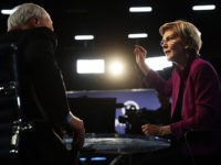 MIAMI, FLORIDA - JUNE 26: Sen. Elizabeth Warren (D-MA) speaks to the media in the spin room following the first night of the Democratic presidential debate on June 26, 2019 in Miami, Florida. A field of 20 Democratic presidential candidates was split into two groups of 10 for the first …