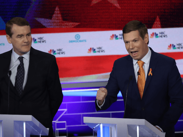 Rep. Eric Swalwell (D-CA) speaks as Sen. Michael Bennet (D-CO) looks on during the second night of the first Democratic presidential debate on June 27, 2019 in Miami, Florida. A field of 20 Democratic presidential candidates was split into two groups of 10 for the first debate of the 2020 …