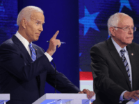 Democratic presidential candidate former Vice President Joe Biden speaks as Sen. Bernie Sanders (I-VT) looks on during the second night of the first Democratic presidential debate on June 27, 2019 in Miami, Florida. A field of 20 Democratic presidential candidates was split into two groups of 10 for the first …