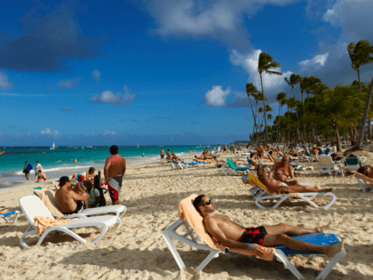 Tourists rest at Bavaro beach, in Punta Cana, Dominican Republic, on January 16, 2012. Tourism is the main industry in Dominican Republic, and Punta Cana is one of the leading tourist destinations in the Caribbean. AFP PHOTO/ERIKA SANTELICES (Photo credit should read ERIKA SANTELICES/AFP/Getty Images)
