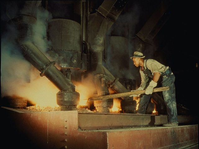 June 1942: Workman at an electric phosphate smelting furnace in a Tennessee Valley Authority chemical plant near Muscle Shoals. (Photo by Alfred T. Palmer/MPI/Getty Images)