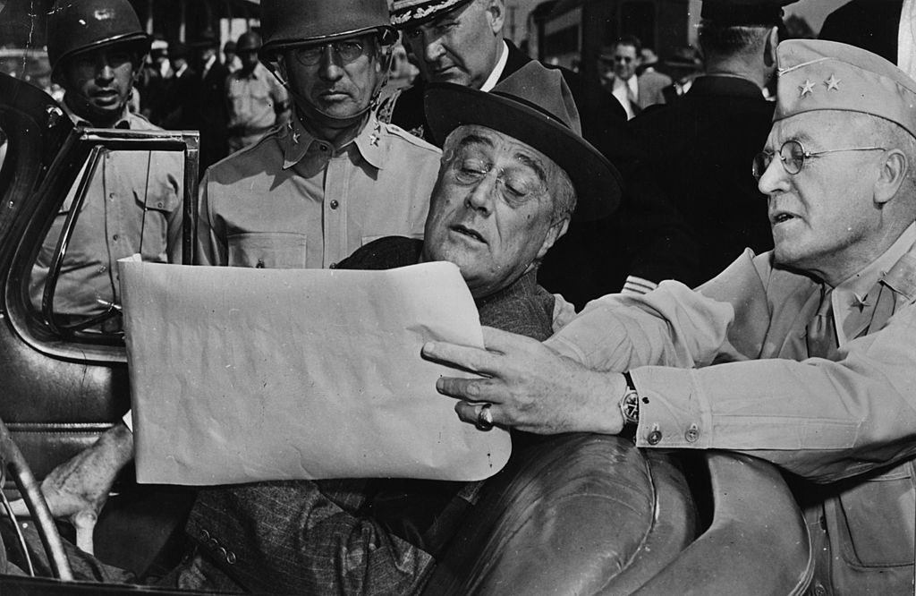 circa 1943: Major General O W Griswold shows President Franklin Delano Roosevelt a map of an American army camp during his nationwide tour of inspection of war plants and military training centres. (Photo by Hulton Archive/Getty Images)
