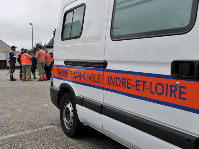 Civil protection rescuers gather as they stay alert in case barriers to stop the flood break as inhabitants of Chapelle-aux-Naux were evacuated following heavy rainfalls, in Vallères, on June 4, 2016. France, Germany and other parts of western and central Europe have been battered by deadly storms and floods over …