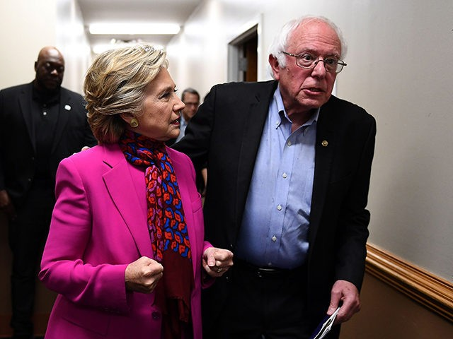 US Democratic presidential nominee Hillary Clinton talks with Bernie Sanders backstage before a campaign rally in Raleigh, North Carolina, on November 3, 2016. / AFP / JEWEL SAMAD (Photo credit should read JEWEL SAMAD/AFP/Getty Images)