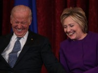 WASHINGTON, DC - DECEMBER 08: Former U.S. Secretary of State Hillary Clinton (R) shares a moment with Vice President Joseph Biden (L) during a leadership portrait unveiling ceremony for Senate Minority Leader Sen. Harry Reid (D-NV) December 8, 2016 on Capitol Hill in Washington, DC. The leadership portrait unveiling ceremony …