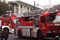 Athens, GREECE: Fire brigade truck are parked in front of the US Embassy in Athens after unknown assailants fired a rocket into the facility early 12 January 2007, causing damage to the building but no casualties, police and US officials said. Police sources said the rocket penetrated the building near …