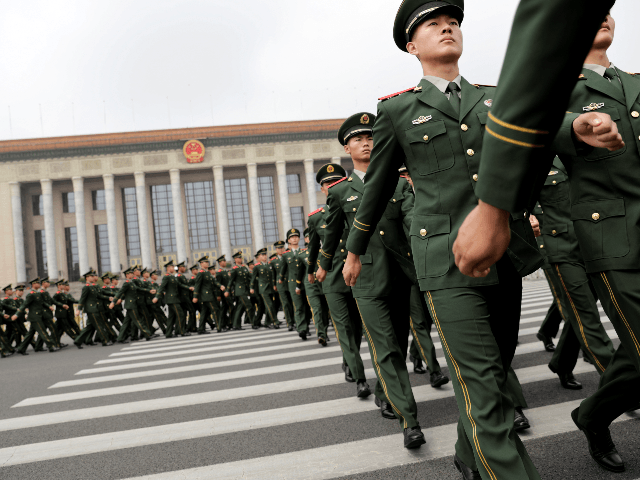 "Chinese paramilitary policemen march outside the Great Hall of the People after attending a ceremony to commemorate the 90th anniversary of the founding of the People's Liberation Army, in Beijing on August 1, 2017. China will fiercely protect its sovereignty against ""any people, organisation or political party"", President Xi Jinping …"