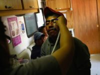 WELLINGTON, CO - SEPTEMBER 16: Migrant outreach worker Jessica Maciel takes the temperature of a migrant farm worker during a check-up in a mobile clinic on September 16, 2009 on a spinach farm near Wellington, Colorado. The Salud Family Health Centers sends the mobile clinic to farms across northeastern Colorado …