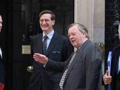 LONDON, ENGLAND - MAY 13: New members of the Cabinet (L-R) Foreign Secretary William Hague, Attorney General Dominic Grieve, Secretary of State for Justice Ken Clarke and Secretary of State for Work and Pensions Iain Duncan Smith stand outside Number 10 Downing Street before attending the new Government's first full …