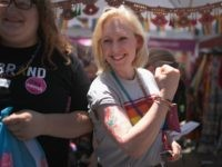 DES MOINES, IOWA - JUNE 08: Democratic presidential candidate and New York senator Kirsten Gillibrand shows off an arm painting she had done during a campaign stop at the Capital City Pride Fest on June 08, 2019 in Des Moines, Iowa. Most of the more than 20 candidates seeking the …