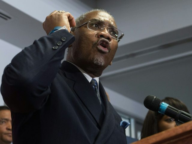 US Democratic Representative from New York and chairman of the Congressional Black Caucus Political Action Committee (CBCPAC) Gregory Meeks announces the CBCPAC's endorsement of Democratic presidential candidate Hillary Clinton for the November election, in Washington, DC, on February 11, 2016. / AFP / Nicholas Kamm (Photo credit should read NICHOLAS …