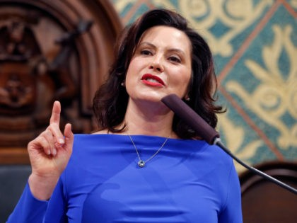 FILE - In this Feb. 12, 2019 file photo, Michigan Gov. Gretchen Whitmer delivers her State of the State address to a joint session of the House and Senate at the state Capitol in Lansing, Mich. Whitmer's proposal to significantly increase fuel taxes to fix the roads is paired with …