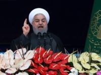 Iranian President Hassan Rouhani speaks during a ceremony celebrating the 40th anniversary of the Islamic Revolution, at the Azadi, Freedom, Square in Tehran, Iran, Monday, Feb. 11, 2019. Speaking from a podium in central Tehran, Rouhani addressed the crowds for nearly 45 minutes, lashing out at Iran's enemies - America …