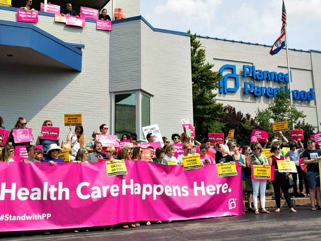 Abortion rights advocates supporters and staff of Planned Parenthood hold a rally outside the Planned Parenthood Reproductive Health Services Center in St. Louis, Missouri on May 31, 2019, the last location in the state performing abortions.Saul Loeb / AFP - Getty Images
